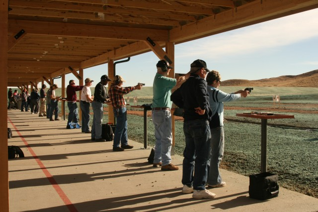 FORT CARSON, Colo. -- Community members take aim at targets on opening day of the Cheyenne Mountain Shooting Complex, Wednesday.