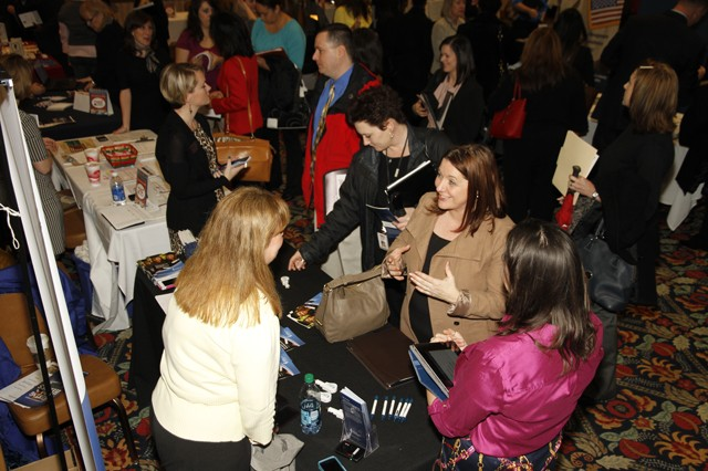 Job applicants crowd around several booths at the Military Spouses Business Alliance Career Forum at the Fort Belvoir Community Center, Jan. 16.