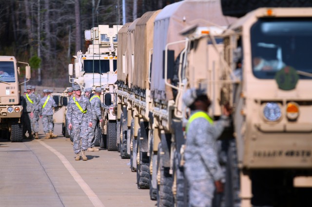 "FORT POLK, La. "" Soldiers from the 4th Brigade Combat Team, 101st Airborne Division, line up military vehicles to get them outfitted with MILES gear before moving them out to their appointed Forward Operating Base at the Joint Readiness Training Center on January 11, 2013, at Fort Polk, La.  (U.S. Army photo by Spc. Justin A. Moeller, 4th Brigade Combat Team Public Affairs)"