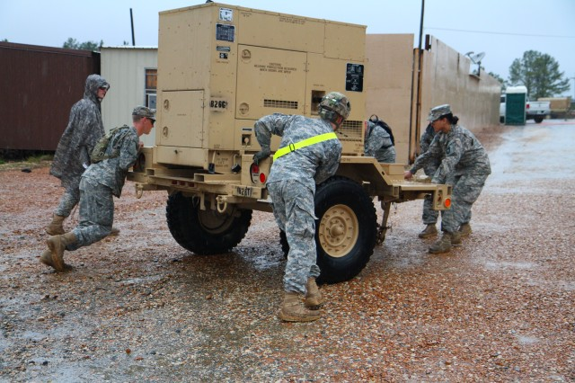 "FORT POLK, La. "" Soldiers from the 4th Brigade Combat Team, 101st Airborne Division, manually move a generator while setting up Forward Operating Base Sword during their rotation at the Joint Readiness Training Center on January 9, 2013, at Fort Polk, La.  (U.S. Army photo by Spc. Justin A. Moeller, 4th Brigade Combat Team Public Affairs)"