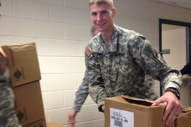 Spc. Joshua Mathis, U.S. Army Ordnance School, helps unload 16 cases of donated dog food and various pet supplies for the Chesterfield County Humane Society Jan. 22. The effort was part of the Ordnance School's support of the Community Connect Program.