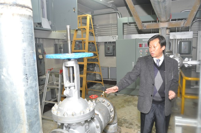 Ukun Chong, foreman of the Water and Waste Branch for U.S. Army Garrison Yongsan's Directorate of Public Works, in South Korea, explains the positive outcomes of replacing the 40-year-old in-line pumps to a new cost-effective pump, Jan. 23, 2013.