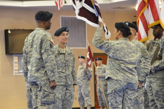 Col. Michelle Fraley, second from left, prepares to receive the brigade colors from Col. Jean Whalen during an assumption of command ceremony for National Capital Region Warrior Transition Brigade held Jan.17 at Naval Support Activity Bethesda. The passing of the brigade colors is a symbolic transfer of responsibilities from one commanding officer to the next.
