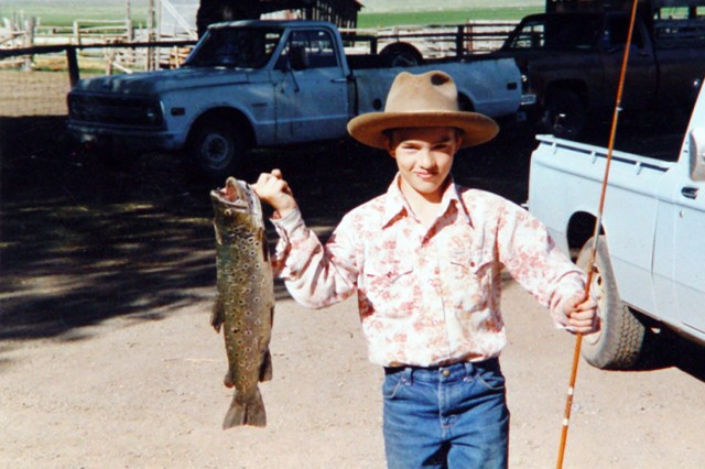 A young Clint Romesha fishes for brown trout at his Grandfather's ranch in Nevada.