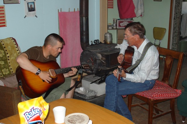Clint Romesha takes a break to play guitar with his uncle, Lynn.