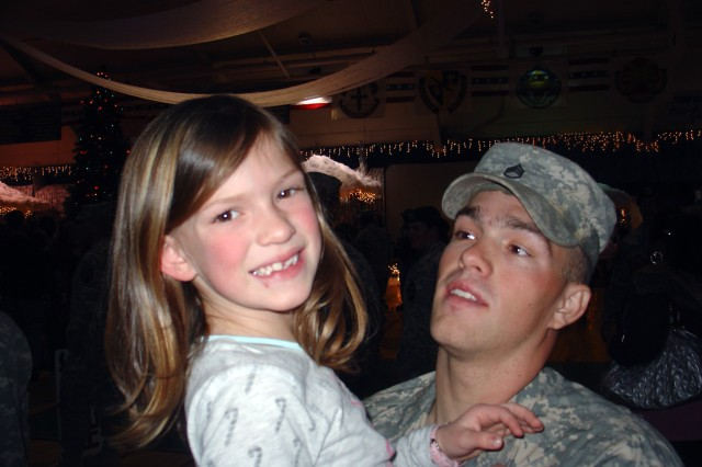 Dessi welcomes home Staff Sgt. Clint Romesha after his second tour in Iraq.