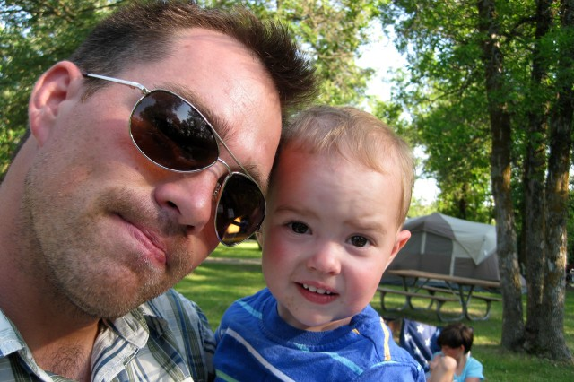Clint Romesha with 1-year old son Collin, during a camping trip at Lake Metigoshe, N.D., in July of 2012.