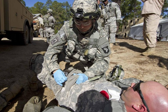 Sgt. Christopher Herbert, a combat medic assigned to Company C, 801st Brigade Support Battalion, 4th Brigade Combat Team, 101st Airborne Division, treats a fellow soldier who has a simulated lower during a combat convoy situational training exercise at the Joint Readiness Training Center in Fort Polk, La., Jan. 20. Herbert, a native of Dallas, assisted his fellow soldiers by providing tactical combat casualty care during the rotational pre-deployment training exercise.U.S. Army photo by: Sgt. Terence Ewings, 24th Press Camp Headquarters