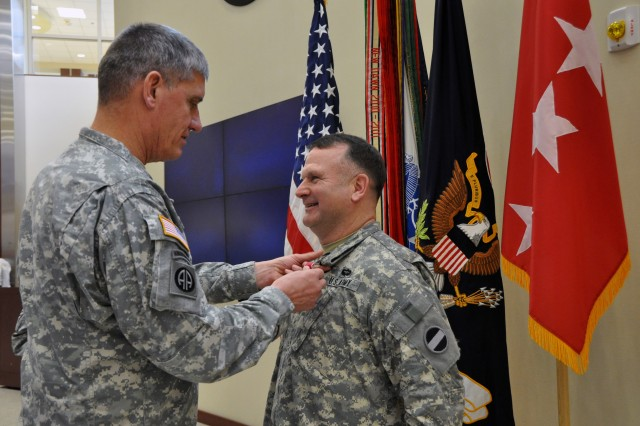 Gen. David M. Rodriguez, commanding general, U.S. Army Forces Command (FORSCOM), presents the Legion of Merit to Col. Norman F. Allen during a General Officer/Senior Executive Service member farewell ceremony, Jan. 25, 2013, in General George C. Marshall Hall, at Fort Bragg, N.C. Allen, who had served as the command's staff judge advocate, leaves Fort Bragg for assignment as the staff judge advocate for the International Security Assistance Force in Afghanistan.