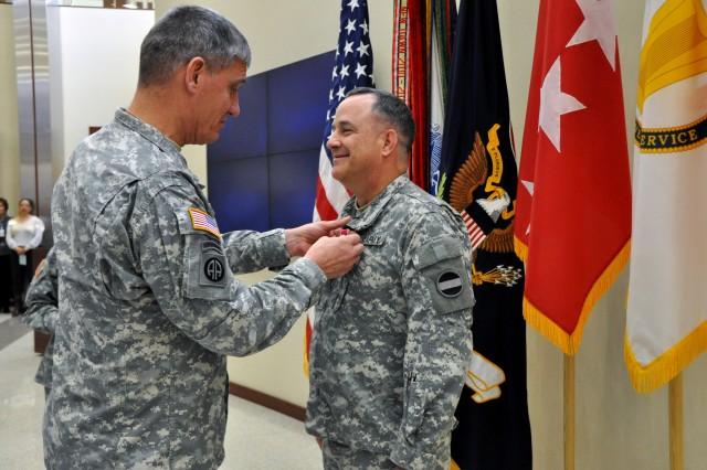 Gen. David M. Rodriguez, commanding general, U.S. Army Forces Command (FORSCOM), presents the Legion of Merit to Brig. Gen. Kenneth C. Roberts during a General Officer/Senior Executive Service member farewell ceremony, Jan. 25, 2013, in General George C. Marshall Hall, at Fort Bragg, N.C. Roberts, who had served as the command's director of operations, aviation and maneuver support, leaves Fort Bragg for assignment as the deputy chief of staff, G3 (Operations), U.S. Army Central, Shaw Air Force Base, S.C.