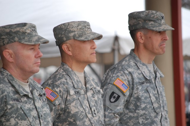 Maj. Gen. Richard Thomas, Maj. Gen. M. Ted Wong and incoming Commander Col. Kyle D. Campbell stand at attention in a Change of Command/Responsibility ceremony Jan. 24 at the Joint Base San Antonio-Fort Sam Houston's MacArthur Parade Field.