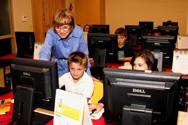 Lois Gannon, fifth-grade teacher, Jordan Catholic School, Rock Island, Ill., instructs Ted Fogel, student, Oct. 19, 2012.