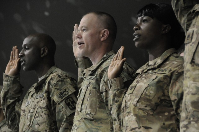 Sergeant Ibilola Animashaun (far right), a supply sergeant in the 582nd Medical Logistics Company, calls Oakland, Calif. home after emigrating from Nigeria to the United States, recites the NCO Charge along with 24 other noncommissioned officers assigned to Task Force Medical-Afghanistan at an induction ceremony held at Bagram Air Field, Jan. 25. (Army Photo by Maj. Charles Patterson, Task Force MED-A Public Affairs / Released)
