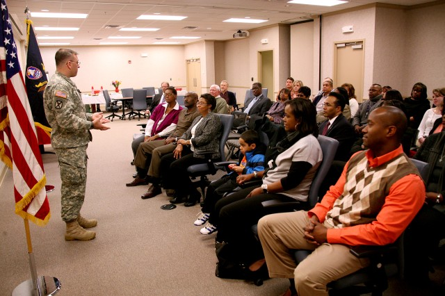 Lt. Col. Brian Soldon, deputy commander, U.S. Army Kwajalein Atoll/Reagan Test Site (CONUS), U.S. Army Space and Missile Defense Command/Army Forces Strategic Command, speaks to those gathered for Belinda Walker's retirement ceremony Jan. 23. Walker was a program analyst for USAKA/RTS and retires with 30 years of service.