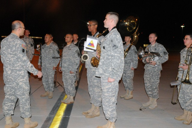 FORT BLISS, Texas - Maj. Gen. William M. Buckler, Jr., commander of 412th Theater Engineer Command, thanked members of the Fort Bliss Band for their part in welcoming home the Soldiers of 420th Eng. Co., 458th Eng. Bn., 411th Eng. Bde., 412thTEC, early morning Friday.