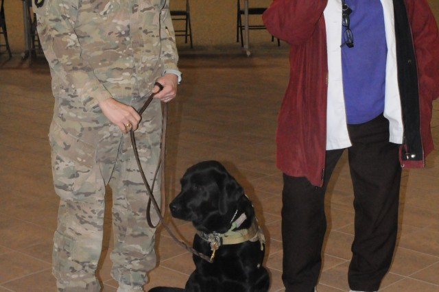 FORT BLISS, Texas - Rosemary Schemmel welcomed home Chaplain (Capt.) Karen Hallett, Zoe the dog and more than 120 Soldiers with 420th Eng. Co., 458th Eng. Bn., 411th Eng. Bde., 412th Theater Engineer Command, early morning Friday.