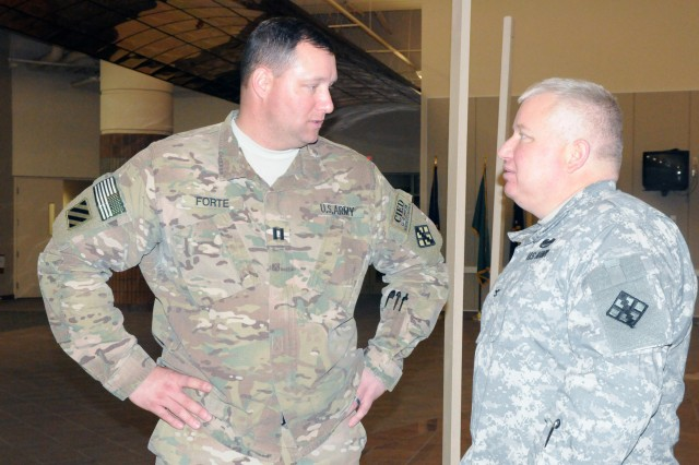 Capt. John Forte, commander of 420th Eng. Co., 458th Eng. Bn., 411th Eng. Bde., 412th Theater Engineer Command, discuss redeployment plans with Col. John Seeley, provisional commander of 411th Eng. Bde.