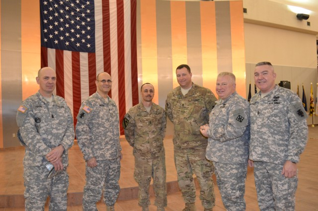 FORT BLISS, Texas - (Left to Right) Command Sgt. Maj. Michael Oddo, interim 411th Eng. Bde. CSM, Maj. Gen. William M. Buckler, Jr., commanding general of 412th Theater Engineer Company, 1st Sgt. Davis of 420th Eng. Co., Capt. John Forte, commander of 420th Eng. Co., Col. John Seeley, provisional commander of 411th Eng. Bde., and Command Sgt. Maj. Steven Hatchell, interim TEC CSM and 926th Eng. Bde. CSM, pictured here shortly after the 420th arrived from Afghanistan early morning Friday.