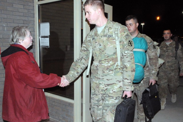 FORT BLISS, Texas - Rosemary Schemmel, known here as volunteer 'mom' for redeployed troops, greeted Soldiers of 420th Eng. Co. minutes after arrival from their end-of-deployment in Afghanistan early morning Friday.