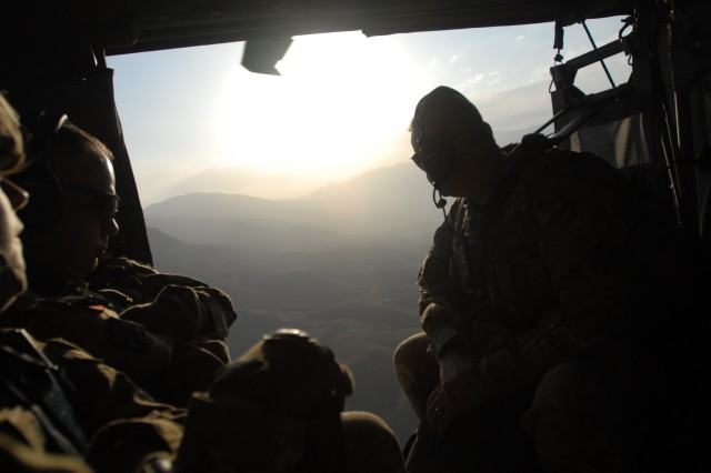 The sun sets behind the mountains in eastern Afghanistan. During its nine-month deployment, Joint Task Force Empire continually consolidated military engineer assets in line with force drawdown, ultimately transitioning engineer effects to a single brigade engineer command for the entire Combined Joint Operations Area - Afghanistan, becoming the fifth largest NATO command element in theater.