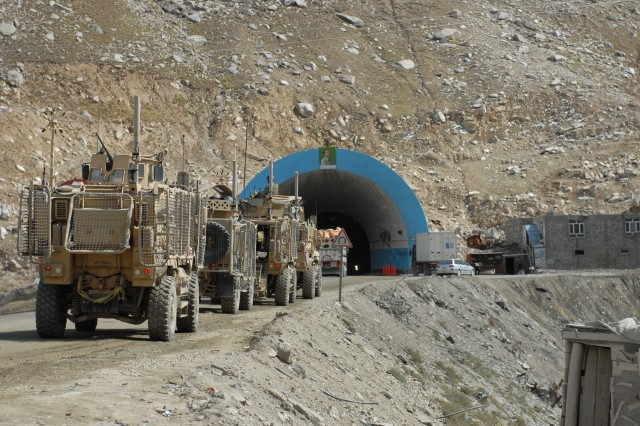 A convoy stages outside the Salang Tunnel during Operation Mountain Blade, an emergency road repair effort to the Salang Pass section of Highway One in the Parwan province, Afghanistan, recently. The operation, conducted by engineering elements of Joint Task Force Empire, improved the road surface of the pass in preparation for winter.