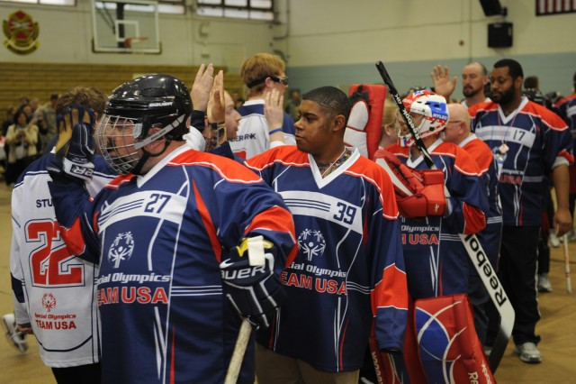 Members of the Team USA Floor Hockey Team congratulate each other after a demonstration on Yongan Garrison in South Korea, Jan. 28, 2013.