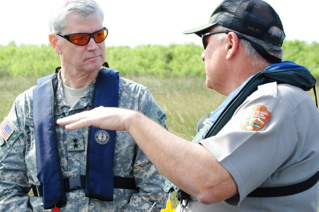 During an airboat ride through the Everglades, Dan Kimball, superintendant of Everglades National Park, discusses Everglades restoration efforts with Maj. Gen. Michael J. Walsh, Deputy Commanding General for Civil and Emergency Operations for the U.S. Army Corps of Engineers, during his visit to south Florida Jan. 23, 2013.