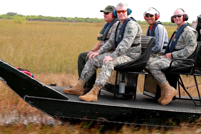 After visiting the Tamiami Trail bridge site, Maj. Gen. Michael J. Walsh, Deputy Commanding General for Civil and Emergency Operations for the U.S. Army Corps of Engineers, took an airboat ride through the Everglades alongside Dan Kimball(left), superintendant of Everglades National Park, Col. Alan Dodd, Jacksonville District commander (right), and Howie Gonzales, chief of the Jacksonville District's Ecosystem Branch Jan. 23, 2013.