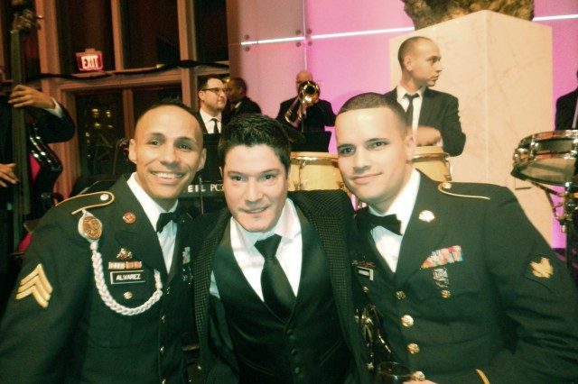 Soldiers who were honored at the Latino Inaugural Gala at the Kennedy Center in Washington, D.C., Jan. 20, 2013, pose with popular Latin singer Frankie Negron.
