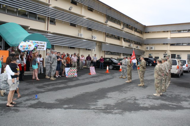 Honolulu Distict family members and District co-workers welcomed home the 565th Engineer Detachment from their nine-month deployment to Afghanistan Jan. 24 in front of District headquarters at Fort Shafter. At the redeployment ceremony Pacific Ocean Division Commander Col. Gregory J. Gunter praised the detachment's spirit of volunteerism.