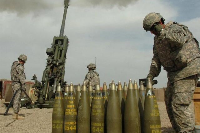 Soldiers fire precision-guided Excalibur cannon ammunition. The Army's Better Buying Power program helped save money in developing 155mm precision Excalibur munitions, according to acquisition officials.