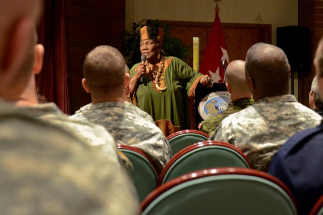 Dr. Maxine Mimms talks about what she experienced throughout the civil rights movement during the JBLM 2013 Dr. Martin Luther King Jr. Birthday Celebration at McChord Field Collocated Club, Jan. 22. (U.S. Army photo by Spc. Nathan Goodall, 17th Fires Brigade Public Affairs)