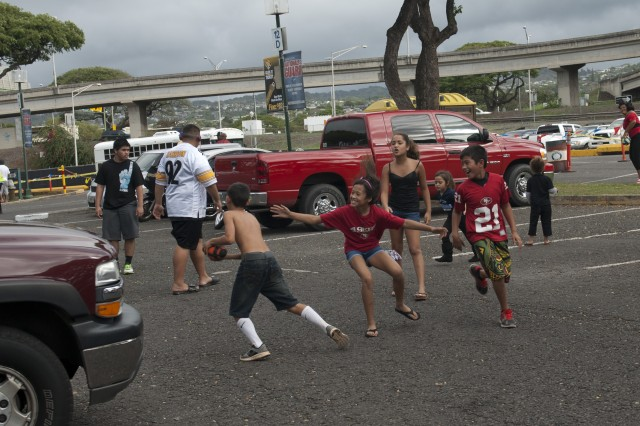 Kids play chase out of Aloha Stadium while tailgating before the National Football League's 2013 Pro Bowl game, Jan. 27.