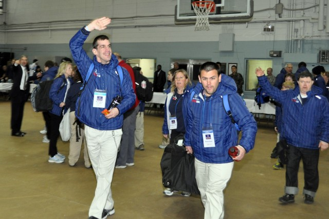 Members of the U.S. Special Olympic Team wave to the crowd as they arrive for the welcome ceremony at Collier Community Fitness Center at Yongsan Garrison Korea, Jan. 28.