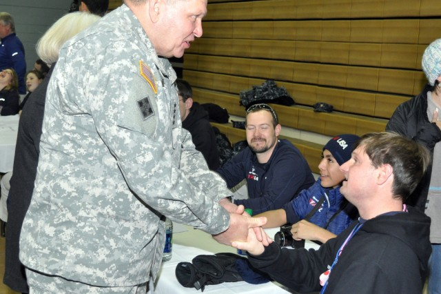 Gen. James D. Thurman, commander of United Nations Command, Combined Forces Command, and U.S. Forces Korea, meets the U.S Special Olympic Team players and encourages them during the welcoming ceremony held at ollier Community Fitness Center at Yongsan Garrison Korea, Jan. 28.