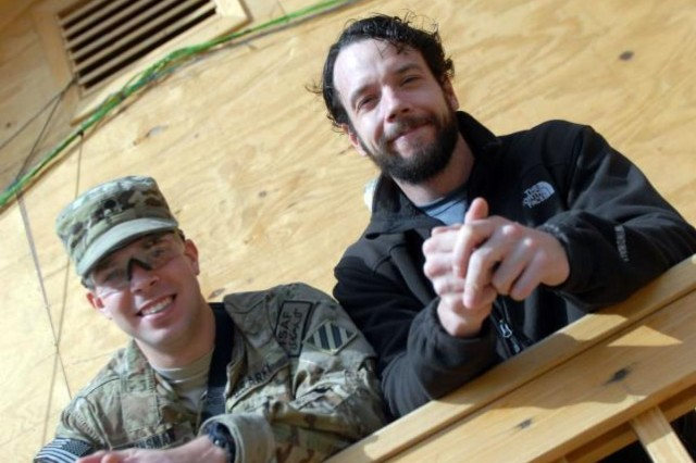 Spc .Kyle Kinsman and his older stepbrother, Mr. James Green, keep family values as a top priority, even while deployed together in Afghanistan.