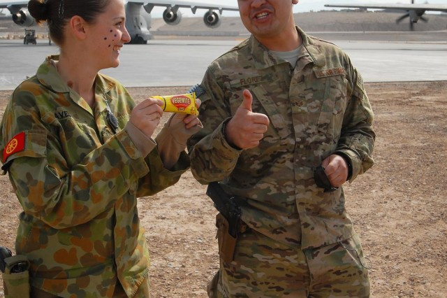 Senior Airman Benjamin Florez, 305th Aerial Support Squadron, 49th Joint Movement Control Battalion, reacts to tasting Vegemite introduced to him by Australian Pvt. Tara Pavel at Multi National Base Tarin Kot, Afghanistan, on Jan. 26, 2013. Vegemite is an Australian food spread for sandwiches, toast, and biscuits, but for Americans is an acquired taste.