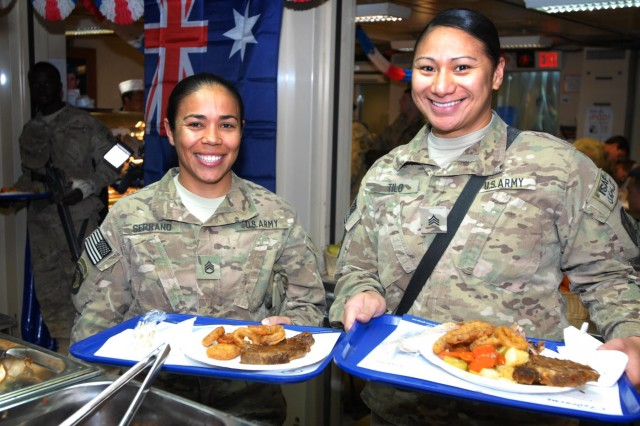 Staff Sgt. Carolina Serrano and Sgt. Lisa Tilo, 82nd Financial Management Support Brigade, celebrate Australia Day by enjoying authentic Australian food at the Holland Dining Facility at Multi National Base Tarin Kot, Afghanistan, on Jan. 26, 2013. Australia Day is typically commemorated with food and gatherings with family and friends.