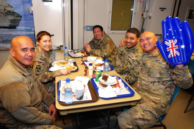 Members of the U.S. Navy enjoy Australia Day festivities at the Holland Dining Facility at Multi National Base Tarin Kot, Afghanistan, on Jan. 26, 2013. Australia Day marks the landing of the first British fleet at Sydney Cove in 1788, and is typically commemorated with food and gatherings with family and friends.