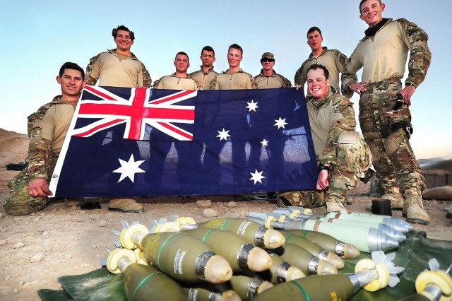 The 7th Battalion Royal Australian Regiment Task Group mortar section pause during training at Multi National Base - Tarin Kot, Afghanistan, to reflect on those at home celebrating Australia Day.  Photography by: Leading Seaman Andrew Dakin, 1st Joint Public Affairs Unit