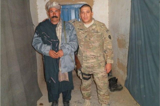 U.S. Security Force Advisory Team Logistical Officer, Lt. Arnulfo I. Villanueva, 56th Infantry Brigade Combat Team, poses for the camera with Afghan Logistical Officer Mohammad Ammin after conducting an operation and logistics brief in the Chorah district of Afghanistan, January 2013. (U.S. CTU Public Affairs Courtesy Photo)
