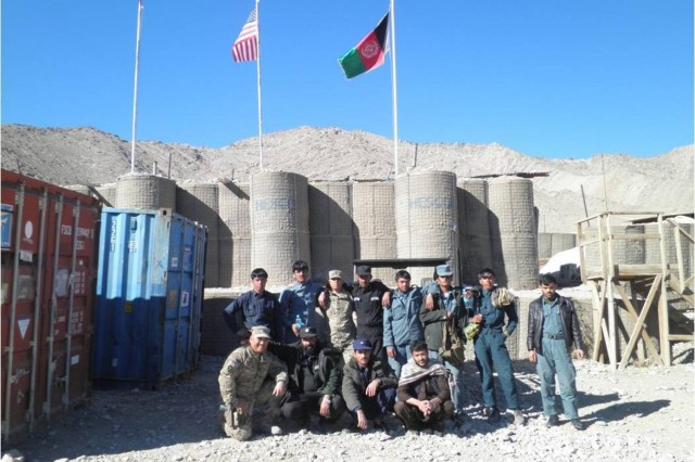 U.S. Security Force Advisory Team and Afghan Uniform Police pose for a group photo after successfully conducting logistics and medical training at Forward Operating Base Mirwais in the Chorah district of Afghanistan, January 2013. (U.S. CTU Public Affairs Courtesy Photo)