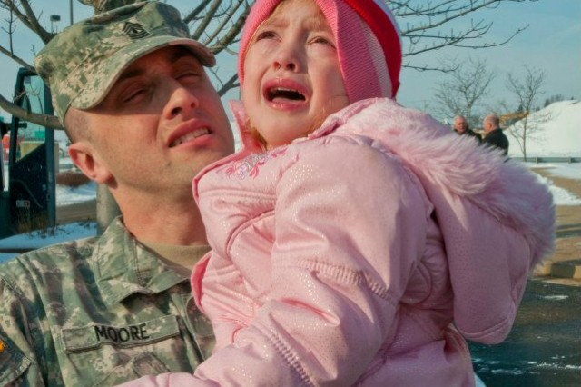 1st Sgt. Nicholas Moore, holds his daughter Alexis for the last time before boarding on the bus to Joint Base Mcguire-Dix-Lakehurst for mobilization training.  Moore will spend about nine months in Afghanistan as the 303rd first sergeant.
