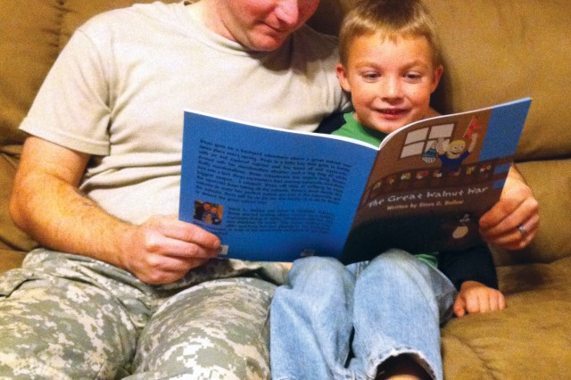 Oklahoma recruiter Sgt. Steve Bellew reads 'The Great Walnut War' to his son, Beau.