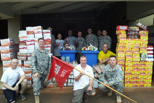"The 84th Engineer Battalion, 130th Eng. Brigade, 8th Theater Sustainment Command, collects food items in its third annual ""Never Daunted Food Drive"" in support of the Hawaii Food Bank, recently."