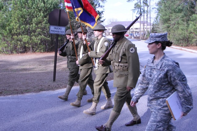 Under the watchful eye of Capt. Christina Teagarden, the 81st Regional Support Command's historical World War I color guard practices for the 57th Inauguration Parade at Fort Jackson, S.C., on Jan. 14. The parade was held in Washington, on Jan. 21. Members of the color guard are, from left to right, retired Col./Dr. John Boyd, Staff Sgt. Jeremy Glasco, Chief Warrant Officer 4 Jeffrey Osler and First Sgt. Thomas White. The Wildcats were one of 105 marching units chosen out of more than 2,000 applicants.