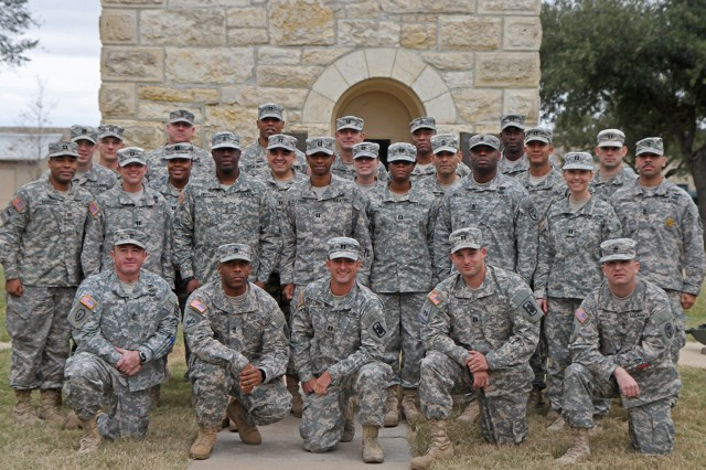 FORT SAM HOUSTON, Texas - Seventeen new company commanders, along with eight first sergeants and a detachment noncommissioned officer, take a break in front of the historic Quadrangle as they attend the U.S. Army North, Company Commander and First Sergeant Training Course. The 26 leaders learned how to best employ the Army programs and benefits designed to help Soldiers. (U.S. Army photo by Staff Sgt. Corey Baltos, Army North PAO)