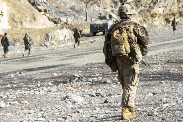 "KHOWST PROVINCE, Afghanistan - Sgt. Kurtis Eisenhuth, an infantryman assigned to 2nd Platoon, Troop C, 1st Squadron, 33rd Cavalry Regiment, 3rd Brigade Combat Team, ""Rakkasans,"" 101st Airborne Division (Air Assault), patrols a main road while Afghan National Army soldiers clear the road ahead in Nadir Shah Kot District, Afghanistan, Jan. 12, 2013. The road was cleared in order to allow vehicles free movement along the road without fears of an improvised explosive device. (U.S. Army photo by Spc. Brian Smith-Dutton, Task Force 3/101 Public Affairs)"