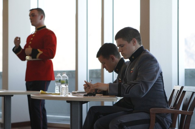 Class of 2013 Cadet Nathan Mayo and Class of 2015 Cadet Ken Voet armed themselves with persuasive argument against RMC Officer Cadets Matt Clancey and Nicholas Huxter in a Canadian parlimentary-style debate. This was Mayo's third debate against RMC through the annual exchange and his second win (2011). Following the debate, the group moved to Robinson Auditorium for a joint Pipe and drum demonstration and trophy presentation.