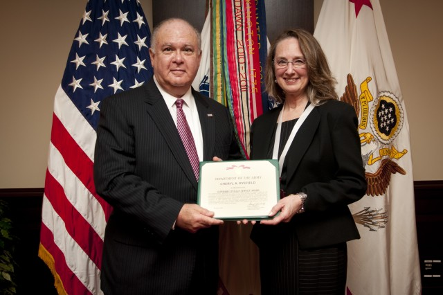 Under Secretary of the Army Joseph W. Westphal hosts the retirement ceremony for Ms. Cheryl Ryefield, after more than 35 years of public service, 30 Jan. 2013, Pentagon, Washington D.C. During his remarks, Westphal discussed the critical role of DA Civilians in support of the U.S. Army and praised Ms. Ryefield's selfless service and dedication; recognizing her as a beacon to others who are pursuing the mantel of public service. During her remarkable career, Ms. Ryefield worked for the Defense Mapping Agency, Defense Logistics Agency, in support of the U.S. Embassy in Thailand, the George C. Marshall European Center for Security Studies, and the Office of the Chief of Public Affairs. She spent the majority of her career as a technical photographer, graphic designer, and video producer; retiring as the Deputy Chief, Electronic Imaging Branch Office of the Chief of Public Affairs. (U.S. Army photo by Staff Sgt. Bernardo Fuller)